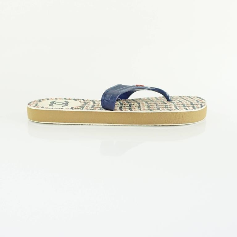 """These Chanel rubber thong sandals are navy and red. On the strap, there is a red Chanel logo. They are in excellent condition.  Measurement Platform height: .75"""""""