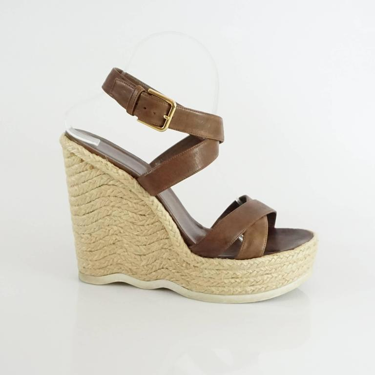 983f530fb07 These YSL wedges are brown leather with a straw wedge that has a white  rubber strip