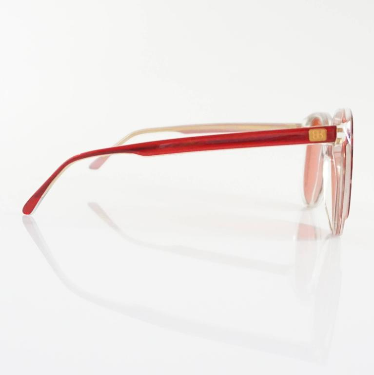 "These fun Balenciaga sunglasses have red lenses and a red and clear Lucite frame. They are in excellent condition. Circa 1980's.   Measurements Leg Length: 5.25"" Front Width: 5 3/8"" Lens Length: 2.5"" Lens Height: 2.25"""