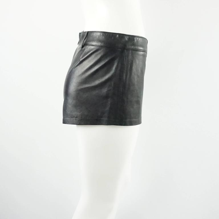 These Ralph Lauren Collection shorts are made of black leather. These shorts have belt loops and no pockets. They are in very good condition with a couple small areas of wear near the top of the shorts by the belt loops.  Measurements Waist: