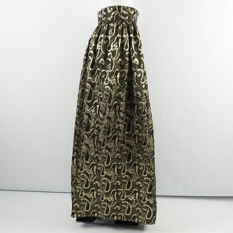 fe1841cf746 This Dolce and Gabbana maxi skirt is a silk brocade fabric in metallic gold  and bronze