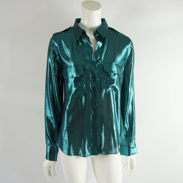 This Lanvin silk lame shirt is an eye-catching metallic teal color. There are 2 front pockets, both with a flap, and hidden buttons going down the front. This shirt is in excellent condition.  Measurements Shoulder to Shoulder: 15.75