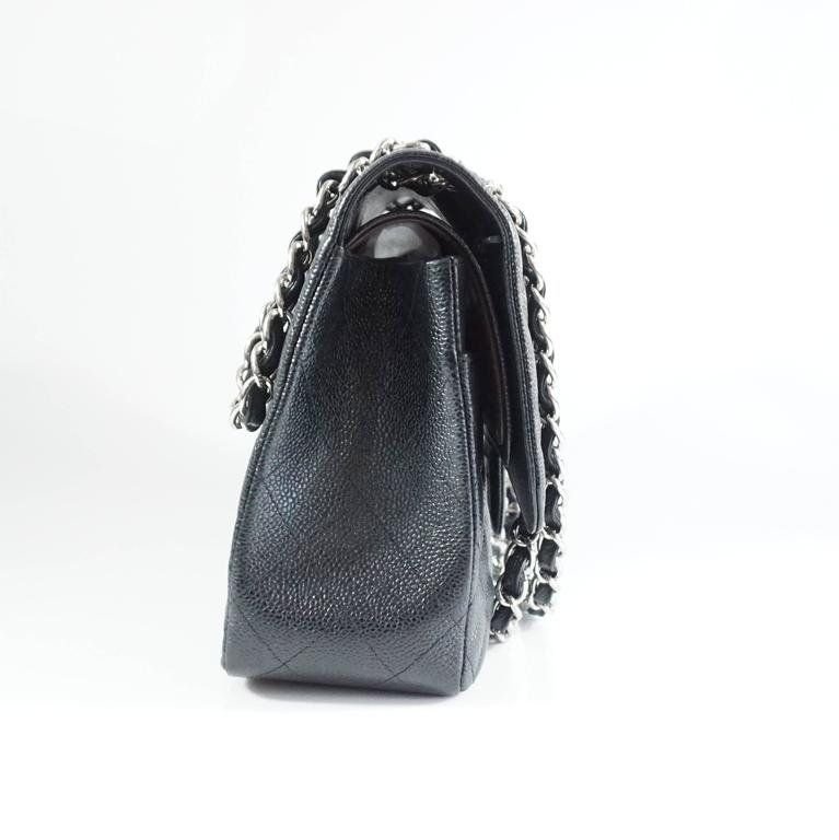 This black caviar Chanel classic double flap bag is a staple. It has silver hardware 4 interior pockets, and 1 exterior pocket. Purchase comes with the original box, duster, tissues, felt protectors, and booklets. The bag is in excellent condition