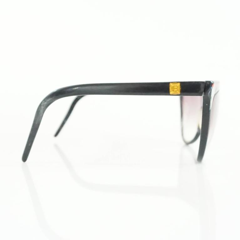 """These Laura Biagiotti sunglasses are black with a red stripe. These sunglasses are in good condition with some markings.  Measurements Length: 6"""" Leg Length: 5"""" Lens Length: 2.5"""" Lens Height: 2.25"""""""