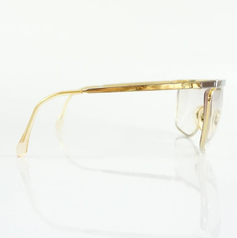 "These Laura Biagiotti glasses are gold and silver. They are in fair condition and have overall wear.  Measurements Length: 6.8"" Leg Length: 4.5"" Lens Length: 2.5"" Lens Height: 2"""