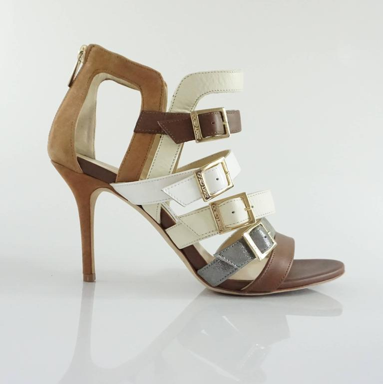 These Jimmy Choo bootie sandals have mixed fabrics (leather, patent leather, suede-like material) and are multicolored with different earthtones. There are straps of dark brown leather, white patent leather, cream leather, and a metallic silver