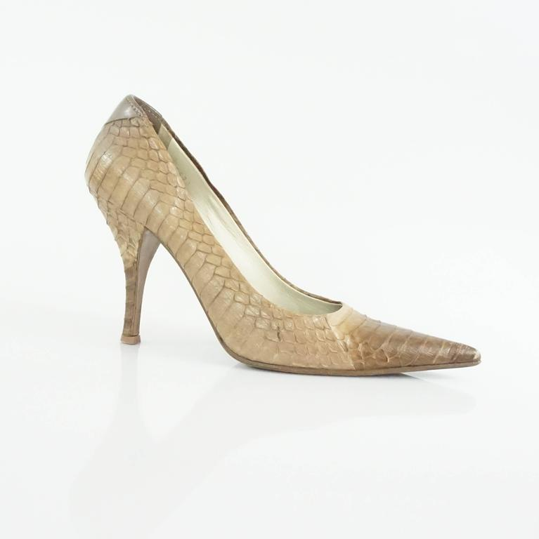 """These Prada pumps have a pointed toe. They are beige python and have a heel. These pumps are in very good condition with minor overall wear.  Heel Height: about 4"""""""