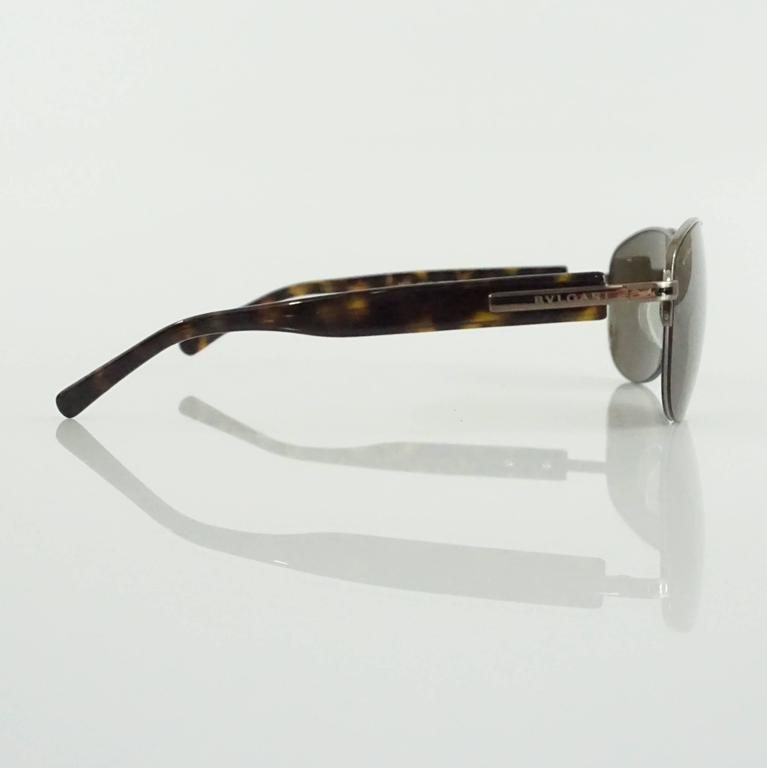"These Bvlgari aviator sunglasses feature silver detailing and tortoiseshell legs. The lenses are brown. These sunglasses are in excellent condition  Measurements Front Length: 5.63"" Leg Length: about 5.25"" Length of Lens: 2.5"" Height"
