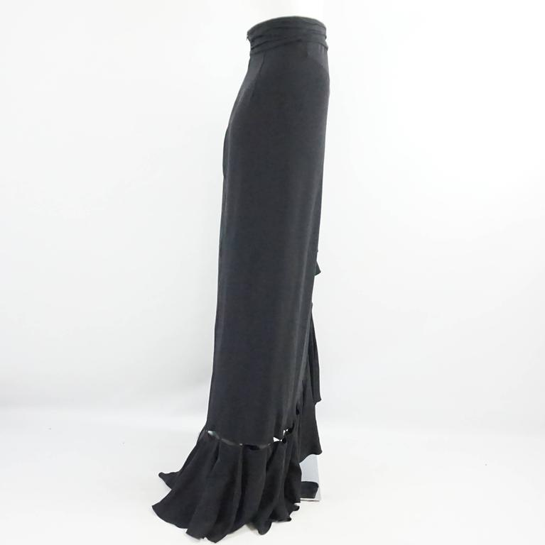f4a5f5bc07 This Naeem Khan black silk maxi skirt has large ruffles along the front and  bottom.