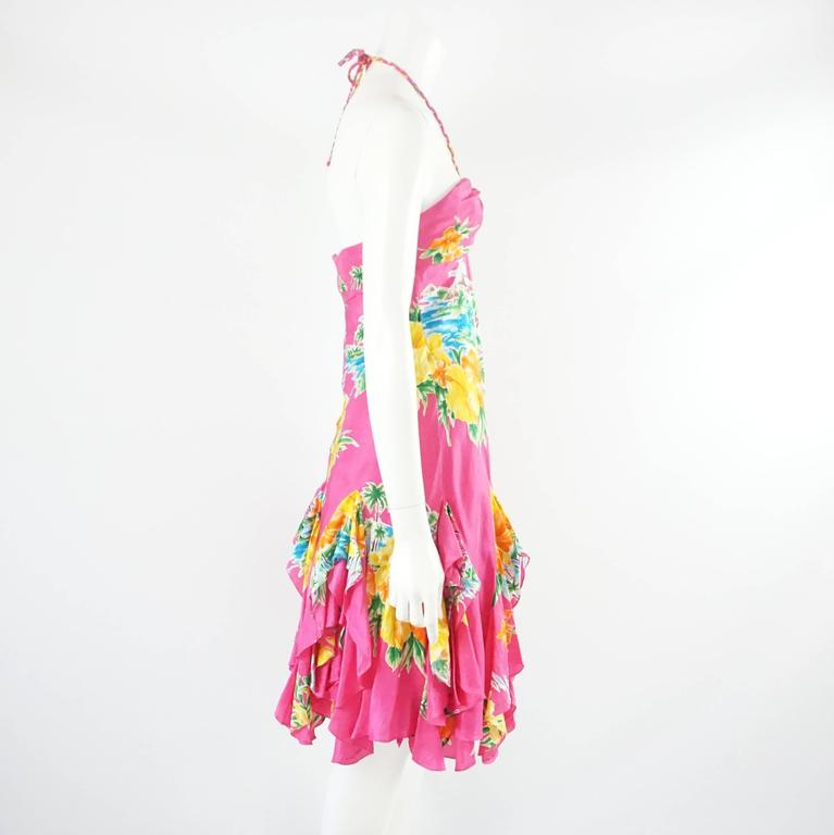 This Ralph Lauren blue label pink tropical print silk dress is a halter style with ruffles all along the bottom. The print has hibiscus flower and palm trees on it and the dress is in good condition with a few runs as seen in the last images. Size