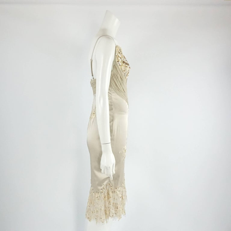Mandalay Silk and Beaded Lace Evening Dress-2. This beautiful Mandalay evening dress is in great condition. It is made of tan silk with gold and ivory lace. This dress has spaghetti straps and the bodice is a v-neckline with beading and sequins.