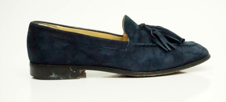 Gucci Vintage Navy Suede Tassel Loafer - 6  These beautiful loafers are in good condition. They are completely covered in suede and have a suede tassel detail in the front. The bottom of the shoe has some wear and the shoe itself has a bit of wear