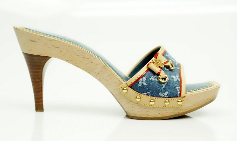 Louis Vuitton Denim Printed Slides - 37  These beautiful heels are in excellent condition. The strap on the heel has a denim detail that has the Louis Vuitton logo on it. The denim detail is lined in a beige and red leather. There are gold studs