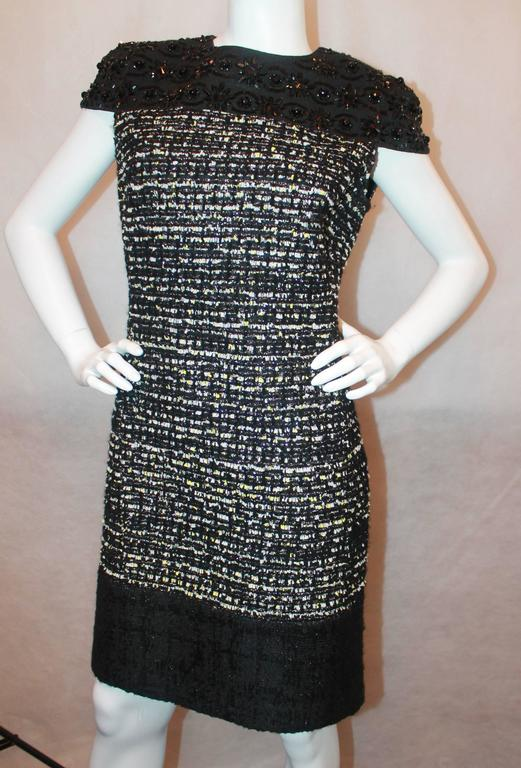 Giambattista Valli Black Stone and Muli Tweed Dress - 10 Top portion of dress is a black silk with cap sleeve and heavy stone work throughout. The main portion of the dress is a black, white, yellow and silver metallic tweed, with a bottom black