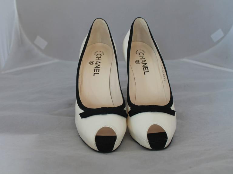 Beige Chanel Ivory & Black Lambskin Peep Toe Pumps w/ Black Ribbon Trim - 40. For Sale