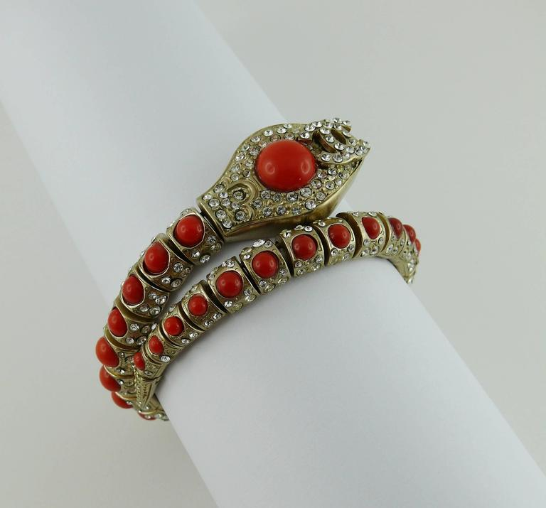 CHANEL gorgeous articulated snake bracelet featuring faux coral stones, clear crystals and interlocking CC logo.  Brushed metal with pale gilt.  Marked CHANEL 08 Made in Italy.  Indicative measurements : inner circumference unstretched approx. 17.29