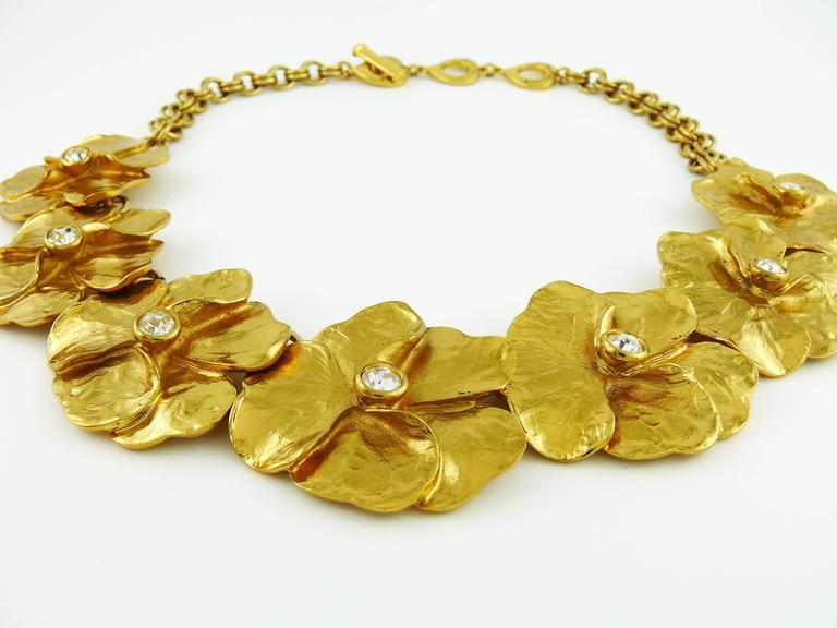 YVES SAINT LAURENT vintage gold tone floral necklace featuring seven beautiful pansies with clear crystal embellishement.  Marked YVES SAINT LAURENT Made in France.  Indicative measurements : total length approx. 51 cm (20.08 inches) / adjustable