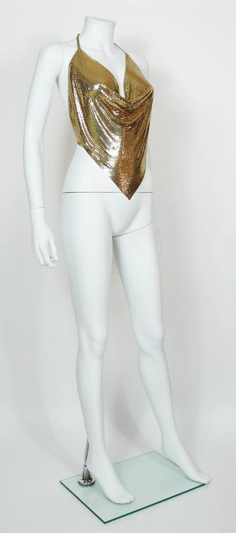 DIAMANT NOIR Paris vintage 1980s disco gold tone metal mesh halter top with gold leather detailing.  Slip on. Ties in the back.  Label reads DIAMANT NOIR.  Composition and size labels are missing. Photographied on a EUR 36 size mannequin (XS). We