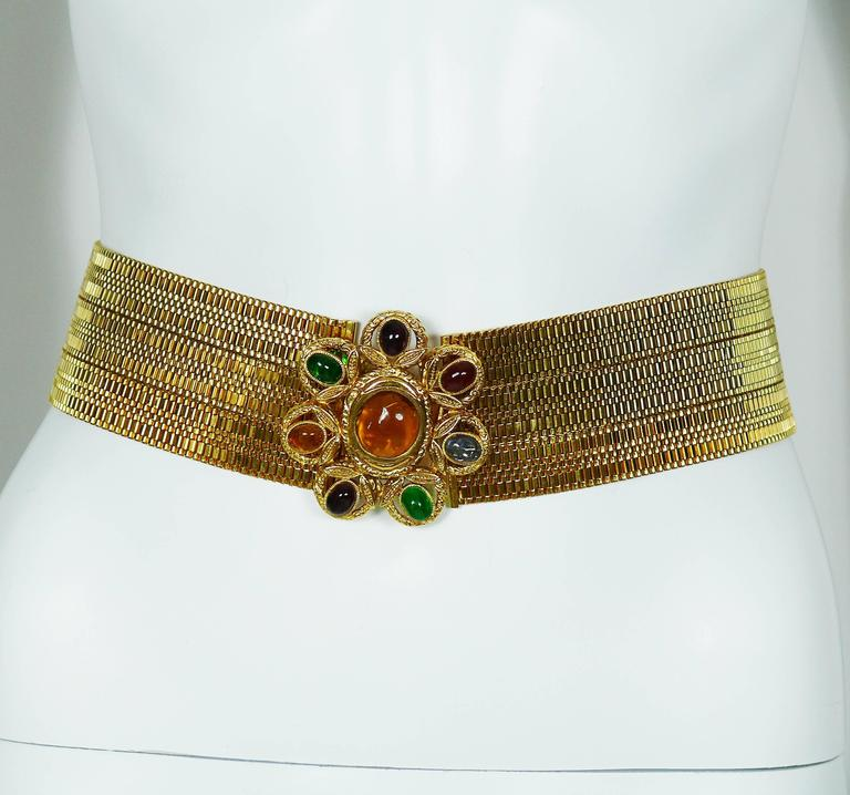 CHANEL vintage museum quality gold tone tick high waist belt featuring a gorgeous GRIPOIX multicolored glass floral buckle.  Fall/Winter 1996/1997 RTW collection (page 222, CHANEL CATWALK, Patrick Mauries, Thames & Hudson).  A similar belt was
