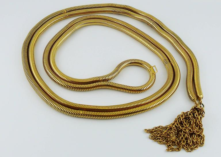 CHRISTIAN DIOR vintage gold toned lariat snake chain belt with tassel.  Hook closure.  Marked CHRISTIAN DIOR.  Indicative measurements : length to 1st hook approx. 70 cm (27.56 inches) / length to 2nd hook approx. 75 cm (29.53 inches) / width