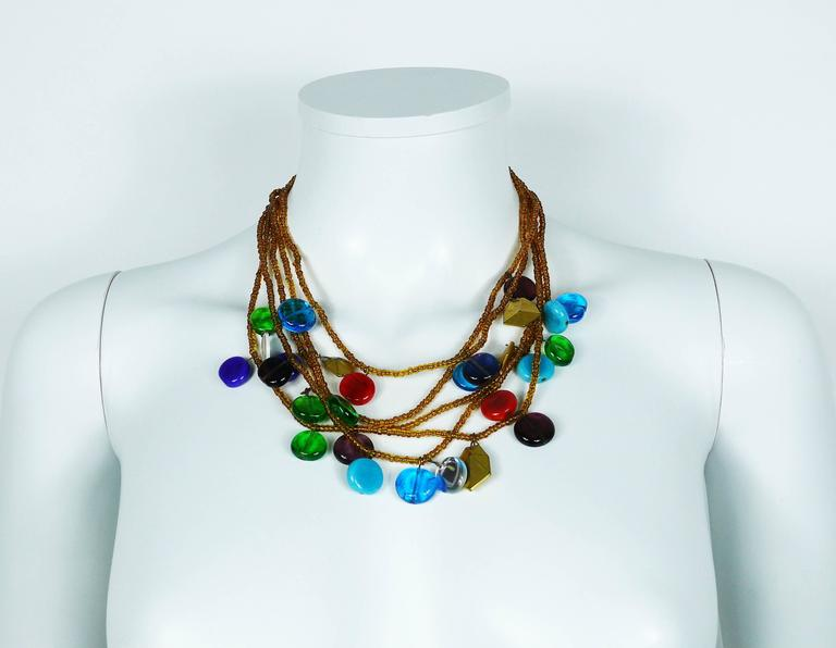 YVES SAINT LAURENT vintage rare multi strand beaded necklace featuring multicolored pate de verre, mirrored and gold toned charms.  This is an early YVES SAINT LAURENT piece of costume jewelry, most probably from the 70s-80s.  Gorgeous blue poured