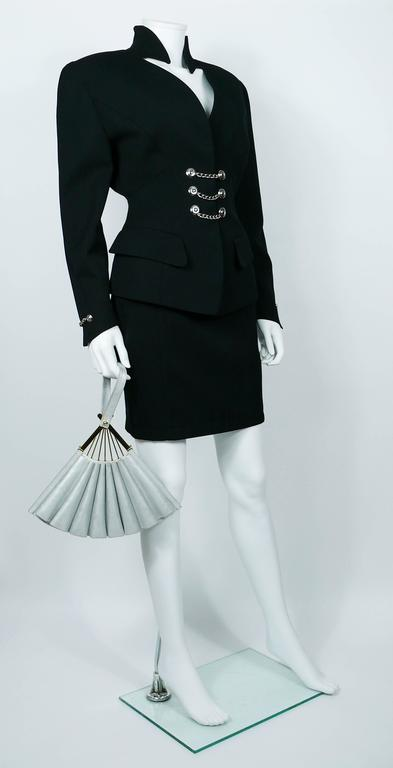 KARL LAGERFELD vintage rare iconic novelty fan bag.  This bag features : - Look-alike fan design. - Silver tanned leather. - Gold toned hardware. - Black silk lining. - One inner zippered pocket. - Two original straps (silver cord and gold toned