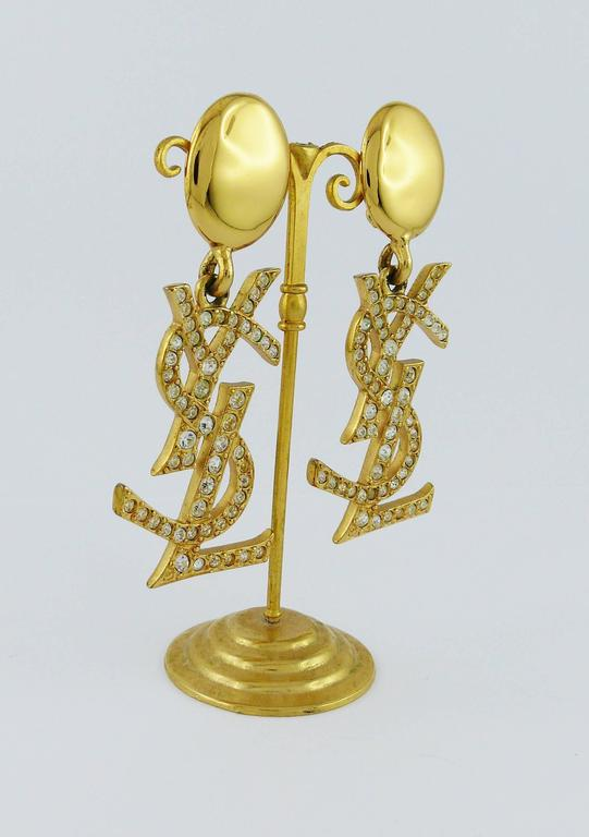 da1df838229 YVES SAINT LAURENT vintage rare massive gold toned dangling earrings  (clip-on) featuring