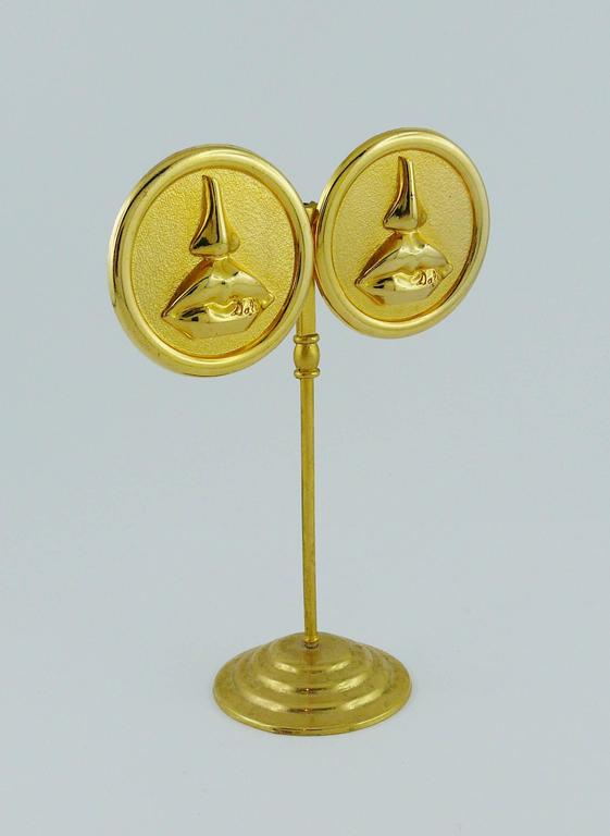 "SALVADOR DALI Parfums vintage 1980's massive gold toned disc earrings (clip-on) featuring the iconic mouth and nose after Aphrodite of Cnidus.  Marked ""Promotion Parfums SALVADOR DALI"".  Indicative measurements : diameter approx. 4 cm"