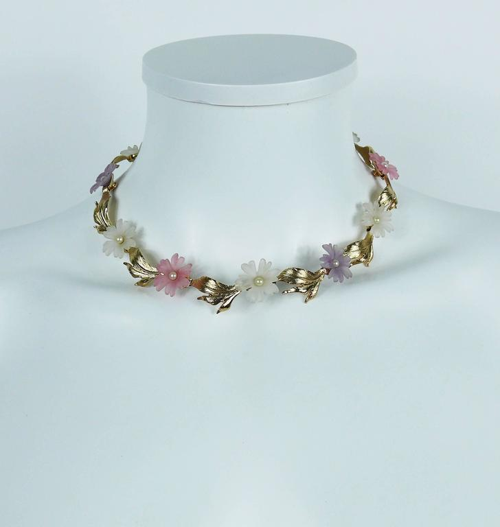 CHRISTIAN DIOR vintage delicate floral necklace featuring gold toned textured leaves alterning with multi colored resin flowers with faux pearl embellishement.  Marked CHR. DIOR Germany. Hanging tag CD.  Indicative measurements : max. length approx.