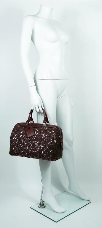 LOUIS VUITTON Limited Edition Sunshine Express Speedy.  This bag features :  - Felted wool body with embroidered sequined iconic Monogram. - Burgundy leather trim. - Gun metal patina hardware. - Dual rolled top handles. - Burgundy fabric lining. -