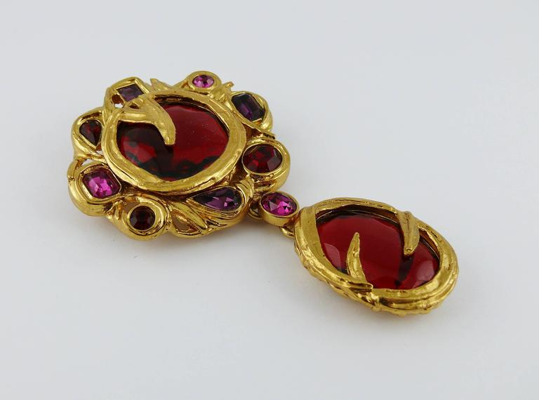 YVES SAINT LAURENT vintage massive brooch featuring multicolored resin cabochons and crystals in a gold toned setting.  Can be worn as a pendant.  Embossed YSL Made in France.  Indicative measurements : length approx. 9.4 cm (3.70 inches) / max.