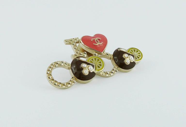 "CHANEL ""I Love Coco"" CC brooch featuring multicolored enamel and faux pearls.  Laser stamping CHANEL G17 C Made in Italy.  Indicative measurements : length approx. 4.2 cm (1.65 inches) / height approx. 2.1 cm (0.83 inch).  Comes with"