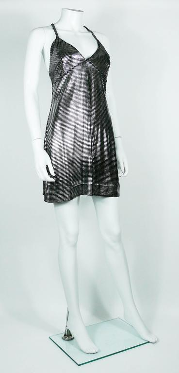 PACO RABANNE sexy silver foil grid mini dress.  Top surface is silver foil printed creating a metallic chain mail effect on a black knit spandex base.  Cross back shoulder straps.  Label reads PACO RABANNE Paris. Made in France  Size tag reads :