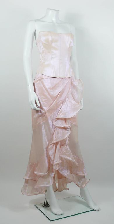 THIERRY MUGLER Couture vintage iridescent pink two piece suit featuring a bustier corset top and a ruffled wrap long skirt.  BUSTIER features : - Fully lined. - Whalebones. - Hidden snap and hook back closure.  SKIRT features : - Wrap cut. -