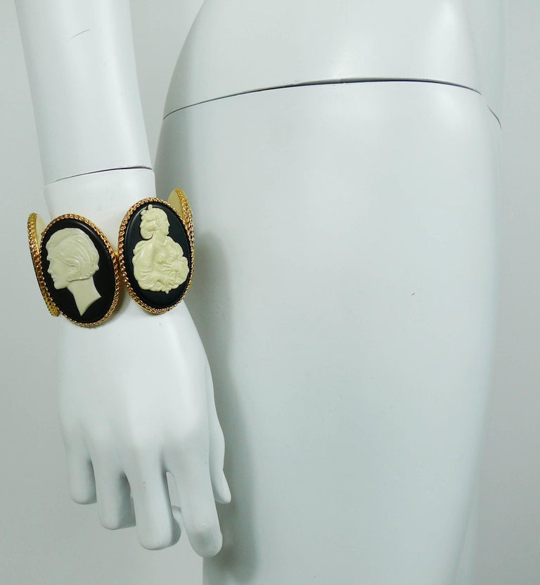 CHANEL vintage uber rare cuff bracelet featuring four large size resin oval cameos (off-white on a black background) in a gold toned setting.  Two cameos feature Mademoiselle CHANEL profile.  A truly collector item, impossible to find !  Embossed