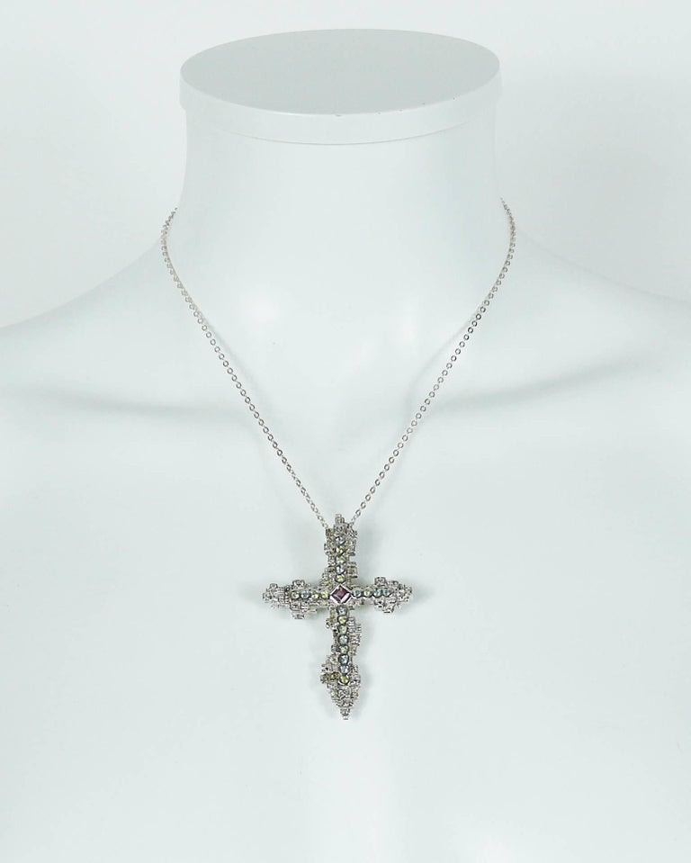 """CHRISTIAN LACROIX sterling silver cross pendant embellished with multicolored crystals.  Can be worn as a brooch.  Sterling silver chain. Spring clasp closure.  French silver hallmark """"Minerve"""" head (on the reverse of the cross). Stamped"""