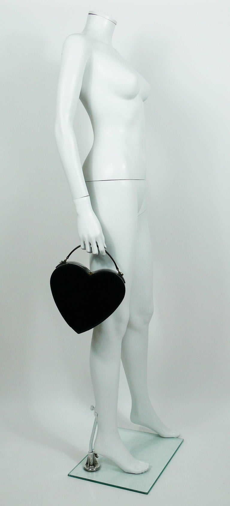 MOSCHINO vintage rare iconic black patent leather heart bag.  This bag features : - Heart shaped rigid body in black patent leather. - Convertible : top handle and shoulder bag (matching strap). - Top push button closure. - Black signature canvas