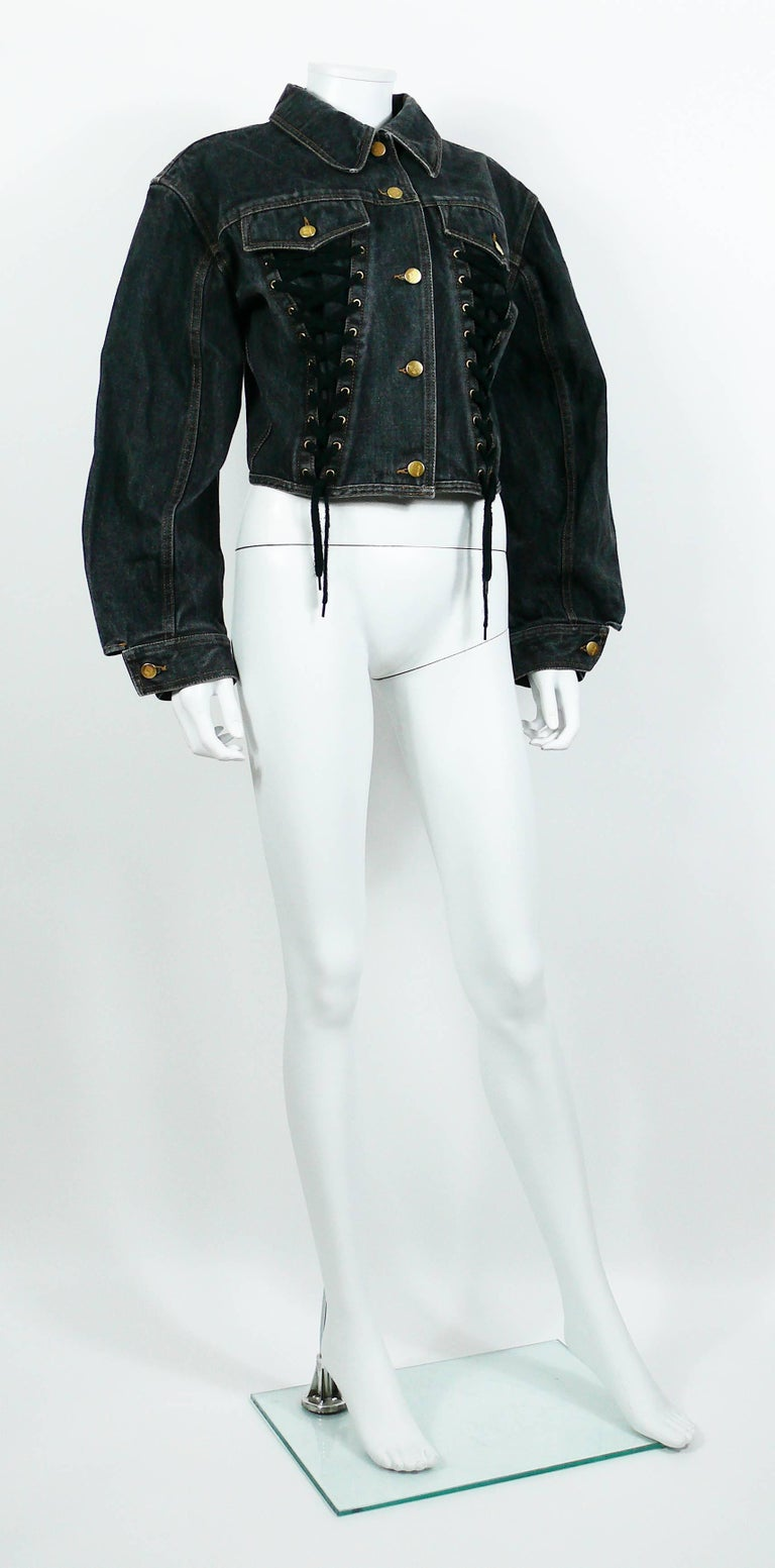 JEAN PAUL GAULTIER Junior vintage black denim iconic corset style jacket.  This jacket features classic collar, front button fastening, front lace up detail, long sleeves with button cuffs and pocket detail at the chest.  Label reads JUNIOR GAULTIER
