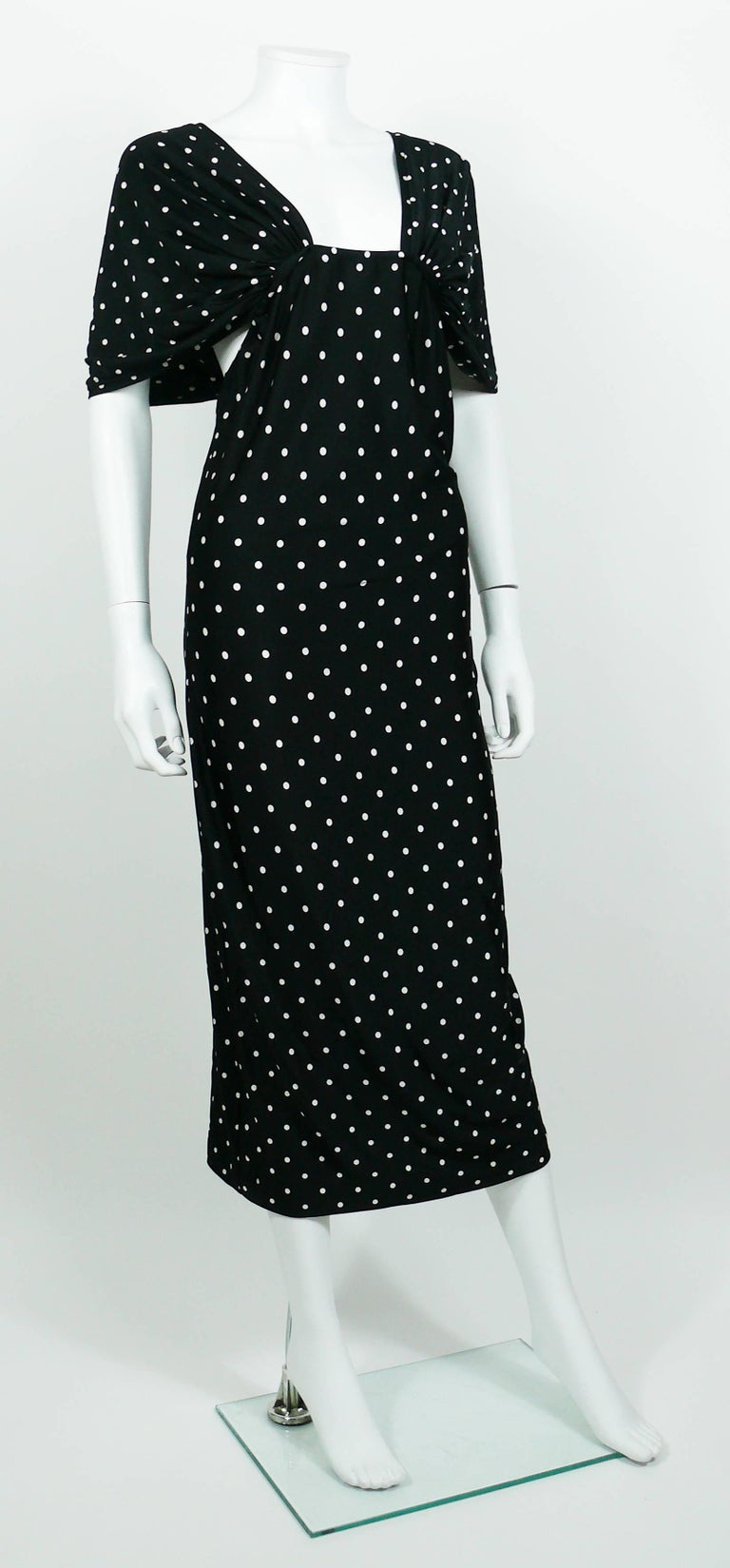 "PATRICK KELLY vintage black and white polka dotted dress featuring ""shawl"" sleeves and plunging back.   Label reads PATRICK KELLY Paris Made in France. Stretchy fabric.  Composition tag reads : 80% Polyamid / 20% Elasthan.  Size tag reads"