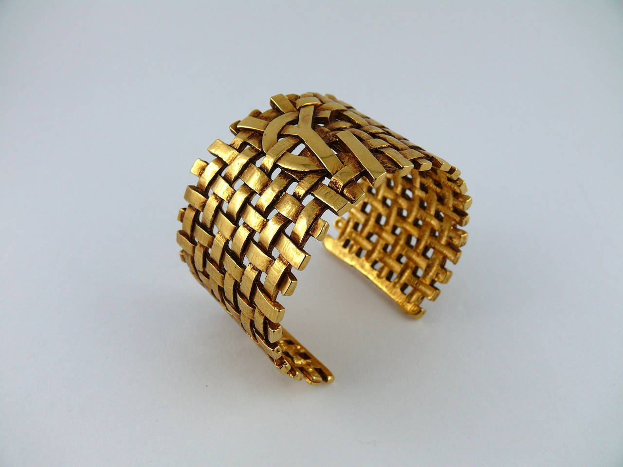 00b466ba2175 YVES SAINT LAURENT vintage openwork woven cuff bracelet featuring a large YSL  monogram. Gold toned
