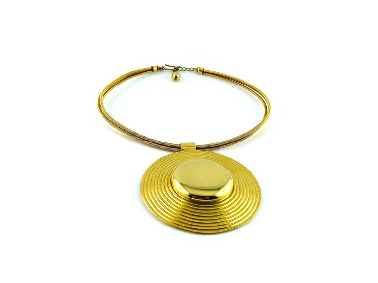 LANVIN vintage gold tone moderneit choker necklace featuring a semi rigid tubular chain and a massive disc pendant with concentric circle design.  Marked LANVIN Paris on the reverse of the pendant.  Indicative measurements : diameter approx. 13