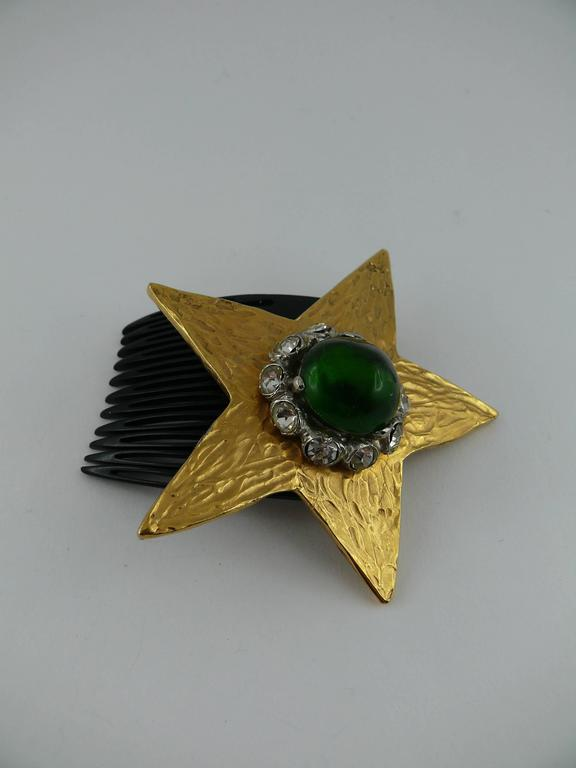 "YVES SAINT LAURENT (attributed to) vintage rare hair comb featuring a textured gold tone star embellished with a green resin cabochon and white crystals.  Unsigned. Marked ""Made in France"".  JEWELRY CONDITION CHART - New or never worn :"