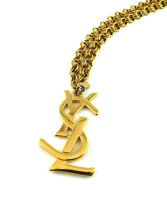 21d32cef3e7 YVES SAINT LAURENT vintage chunky gold tone chain necklace featuring a  large iconic YSL logo.