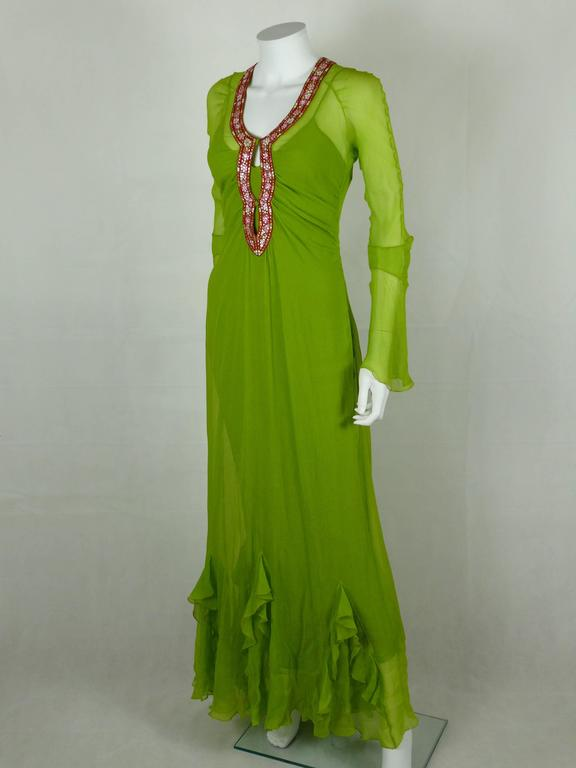 CHRISTIAN DIOR embroidered silk chiffon caftan dress.  This dress is made of green silk chiffon embroidered with an oriental inspired design of stylized flowers with glass pellet embellishement  Silk lining (full length slip).  Beautiful contrast