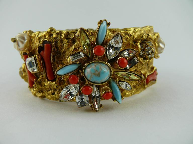 CHRISTIAN LACROIX vintage opulent jewelled clamper bracelet.  Texture gold tone bracelet embellished with multicolored crystals, faux turquoise and coral stones, faux pearls.  Marked CHRISTIAN LACROIX CL Made in France.  Indicative measurements :