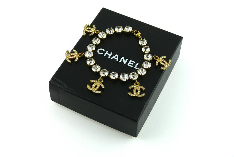 CHANEL vintage gold tone jewelled bracelet featuring five CC signature charms with rhinestone embellishement.  Lobster clasp closure.  Marked CHANEL 95 P Made in France.  Indicative measurements : length approx. 18.5 cm (7.28 inches) / diameter of