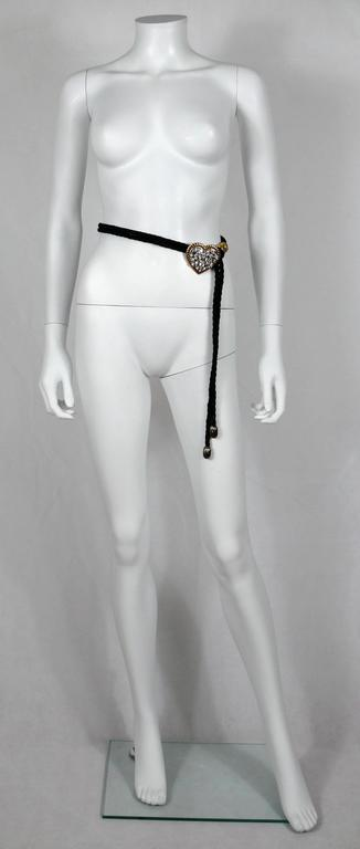 YVES SAINT LAURENT vintage black silk cord belt featuring a gold and silver toned heart with crystal embellishement.  Designed by French parurier ROBERT GOOSSENS.  One size fits all. Adjustable length.  Embossed YSL Made in France.  Indicative