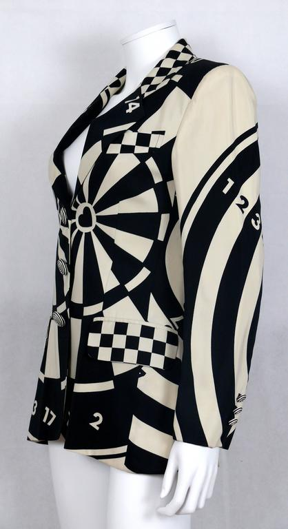 MOSCHINO vintage monochrome blazer featuring a black dartborad print on an off-white background.  Swirl woven buttons on front and cuffs.  Front checked pattern pockets.  Fully lined.  Label reads CHEAP AND CHIC by MOSCHINO Made in Italy.  Marked
