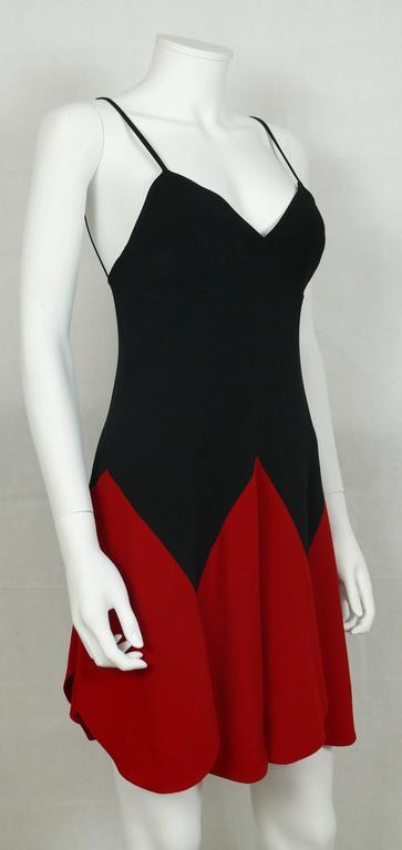 MOSCHINO 1990s vintage iconic heart mini dress.  Fitted cut.  Spaghetti straps.  Side zip closure.  Label reads CHEAP AND CHIC by MOSCHINO Made in Italy.   Marked Size : I 42 / D 38 / F 38 / GB 10 / USA 8. Please double check