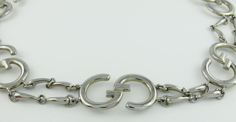 GUCCI vintage 1970s silver toned iconic belt featuring Guccio Gucci GG initials and horsbit links.  Secure clasp system topped with G initial.  Embossed GUCCI an GUCCI Italy.  Indicative measurements : length approx. 73 cm - 74 cm (28.74 inches -